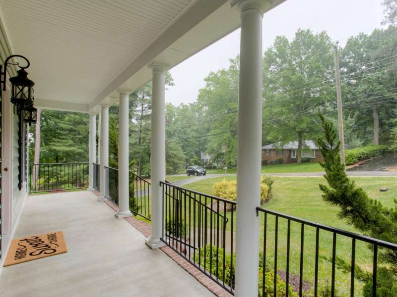 Front porch repaired and remodeled with round coloumns and black aluminum railing in Richmond Va